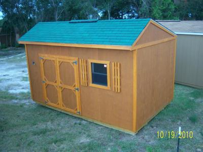 10' x 16' Garden shed in cedar with green shingles